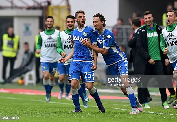 Domenico Berardi of US Sassuolo Calcio celebrates after scoring the first goal during the Serie A match between AC Milan and US Sassuolo Calcio at...