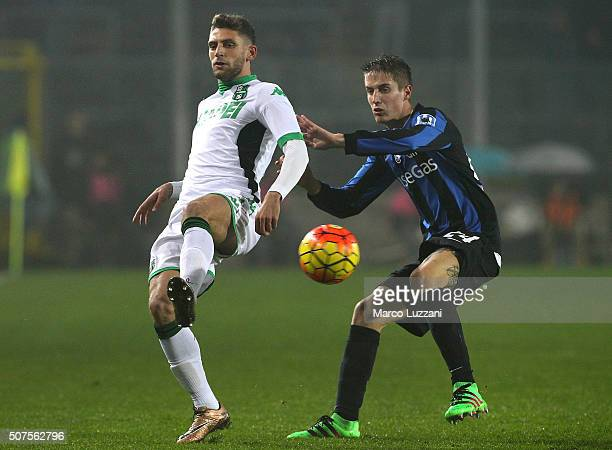 Domenico Berardi of US Sassuolo Calcio competes for the ball with Andrea Conti of Atalanta BC during the Serie A match between Atalanta BC and US...