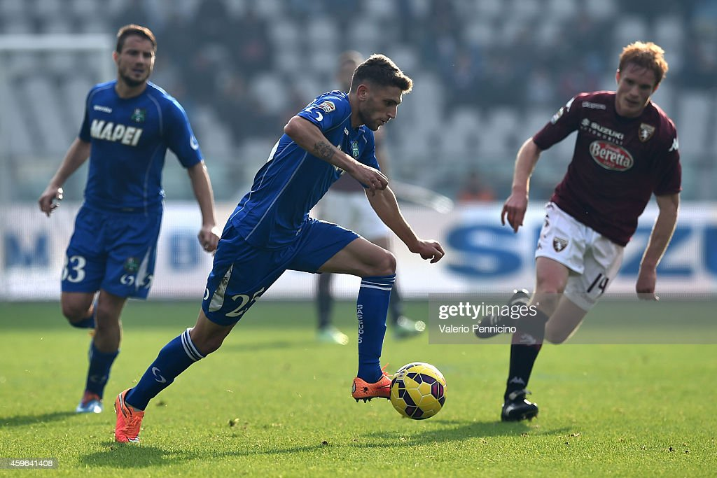 Domenico Berardi of US Sassuolo Calcio in action during the Serie A match between Torino FC v US Sassuolo Calcio at Stadio Olimpico di Torino on November 23, 2014 in Turin, Italy.