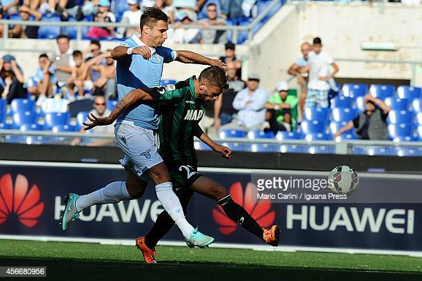 Domenico Berardi of US Sassuolo Calcio is fouled into the penalty area by Lorik Cana of SS Lazio during the Serie A match between SS Lazio and US...