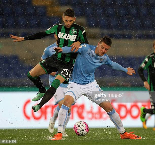 Domenico Berardi of US Sassuolo competes for the ball with Sergej Milinkovic of SS Lazio during the Serie A match between SS Lazio and US Sassuolo...