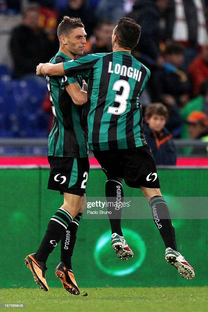 Domenico Berardi (L) with his team-mate Alessandro Longhi of US Sassuolo celebrates after scoring the first goal during the Serie A match between AS Roma and US Sassuolo Calcio at Stadio Olimpico on November 10, 2013 in Rome, Italy.