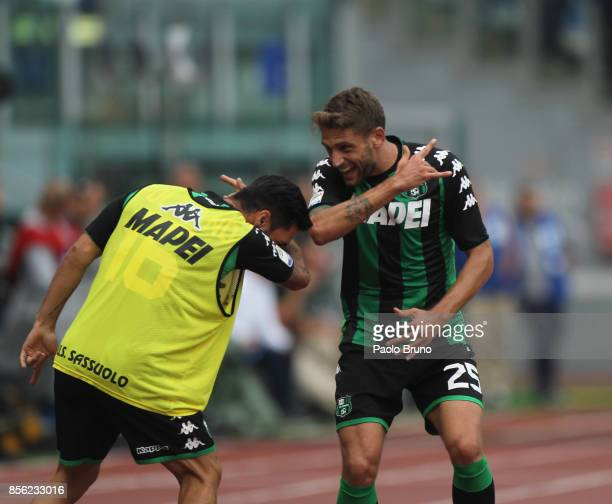 Domenico Berardi with his teammate of US Sassuolo celebrates after scoring the opening goal during the Serie A match between SS Lazio and US Sassuolo...