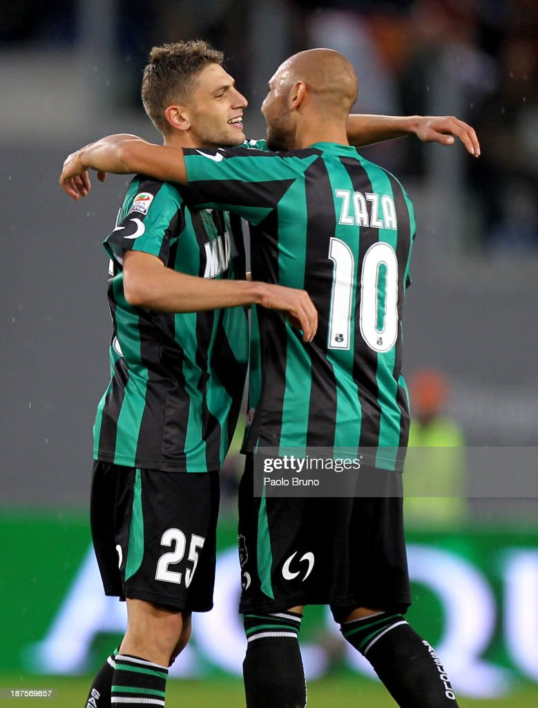 Domenico Berardi (L) with his team-mate <a gi-track='captionPersonalityLinkClicked' href=/galleries/search?phrase=Simone+Zaza&family=editorial&specificpeople=9680372 ng-click='$event.stopPropagation()'>Simone Zaza</a> of US Sassuolo celebrate after scoring the first goal during the Serie A match between AS Roma and US Sassuolo Calcio at Stadio Olimpico on November 10, 2013 in Rome, Italy.