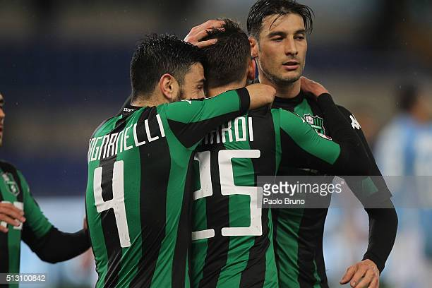 Domenico Berardi with his teammates of US Sassuolo celebrates after scoring the opening goal from the penalty spot during the Serie A match between...