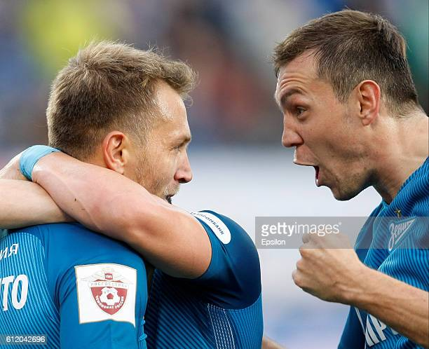Domenico Criscito and Artem Dzyuba of FC Zenit St Petersburg celebrate a goal during the Russian Football League match between FC Zenit St Petersburg...