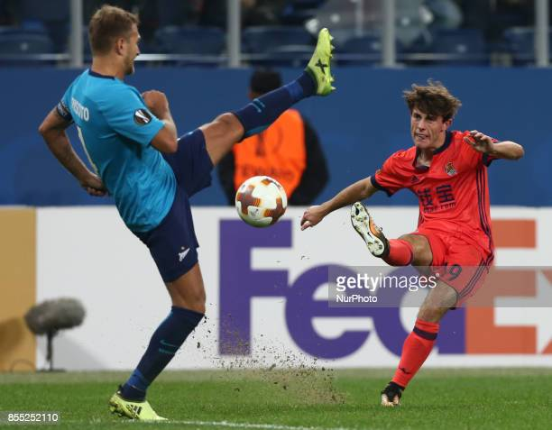Domenico Criscito of FC Zenit Saint Petersburg and Álvaro Odriozola of FC Real Sociedad vie for the ball during the UEFA Europa League Group L...