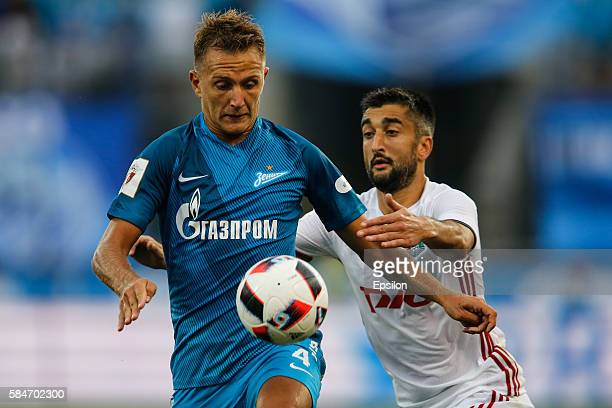 Domenico Criscito of FC Zenit St Petersburg and Aleksandr Samedov of FC Lokomotiv Moscow vie for the ball during the Russian Football League match...