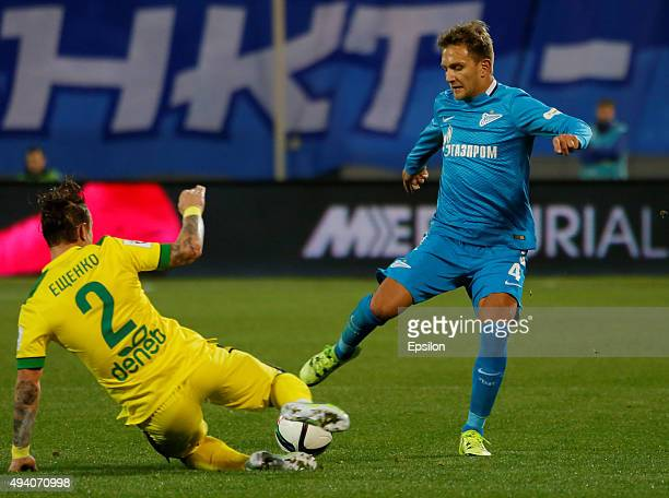 Domenico Criscito of FC Zenit St Petersburg and Andrey Yeshchenko of FC Anzhi Makhachkala vie for the ball during the Russian Football League match...