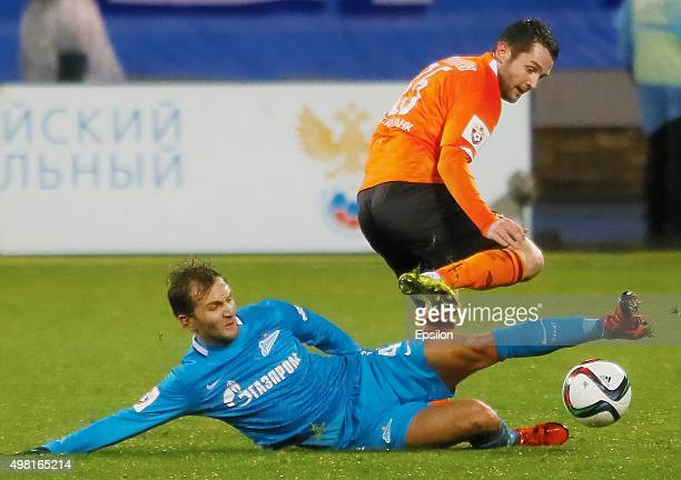 Domenico Criscito of FC Zenit St Petersburg and Denys Kulakov of FC Ural Sverdlovsk Oblast vie for the ball during the Russian Football League match...