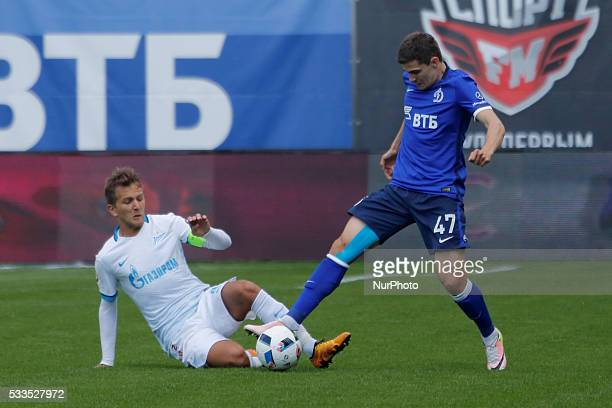 Domenico Criscito of FC Zenit St Petersburg and Roman Zobnin of FC Dynamo Moscow vie for the ball during the Russian Football Premier League match...