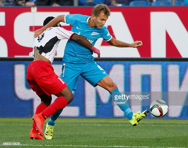 Domenico Criscito of FC Zenit St Petersburg vies for the ball with Brian Idowu of FC Amkar Perm during the Russian Football Premier League match...