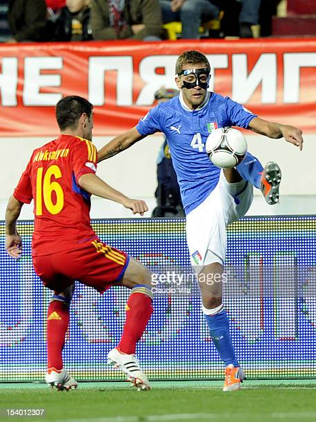 Domenico Criscito of Italy and Valeri Aleksanyan of Armenia compete for the ball during the FIFA 2014 World Cup Qualifier group B match between...