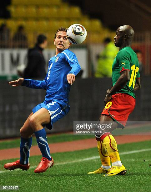 Domenico Criscito of Italy battles for the ball against Achille Emana of Cameroon during the International Friendly match between Italy and Cameroon...
