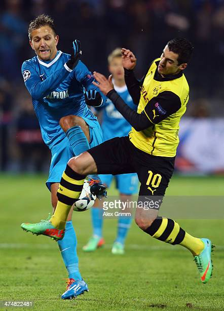 Domenico Criscito of Zenit is challenged by Henrikh Mkhitaryan of Dortmund during the UEFA Champions League Round of 16 match between FC Zenit and...