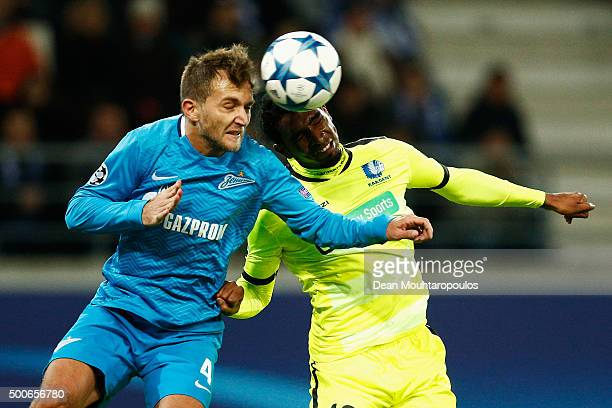 Domenico Criscito of Zenit Saint Petersburg challenges for the headed ball with Renato Cardoso Neto of Gent during the group H UEFA Champions League...