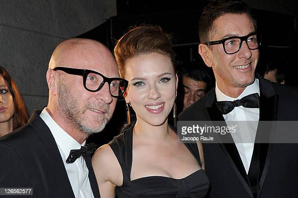 Domenico Dolce Scarlett Johansson and Stefano Gabbana are seen At Dolce Gabbana Gold Restaurant during Milan Womenswear Fashion Week on September 25...