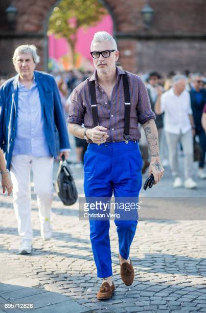 Domenico Gianfrate wearing blue pants with suspenders is seen during Pitti Immagine Uomo 92 at Fortezza Da Basso on June 13 2017 in Florence Italy