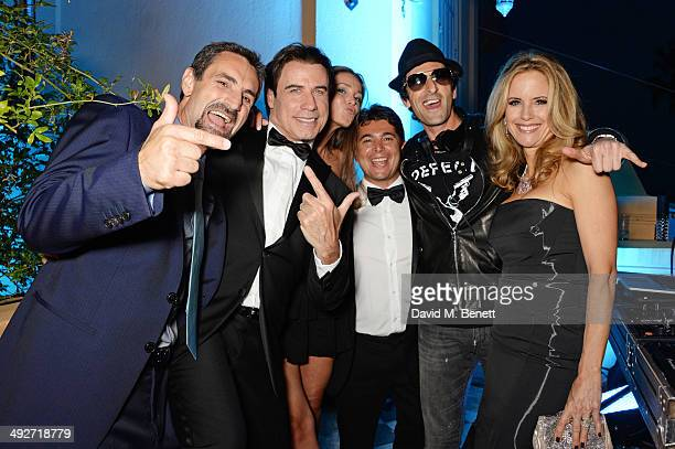 Domenico Giannini John Travolta Lara Leito Oscar Generale Adrien Brody and Kelly Preston attend the welcome party for Puerto Azul Experience Night at...