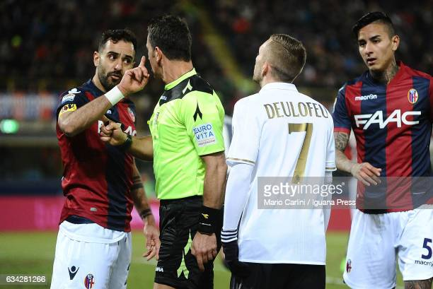 Domenico Maietta of Bologna FC argues with Gerard Deulofeu of AC Milan during the Serie A match between Bologna FC and AC Milan at Stadio Renato...