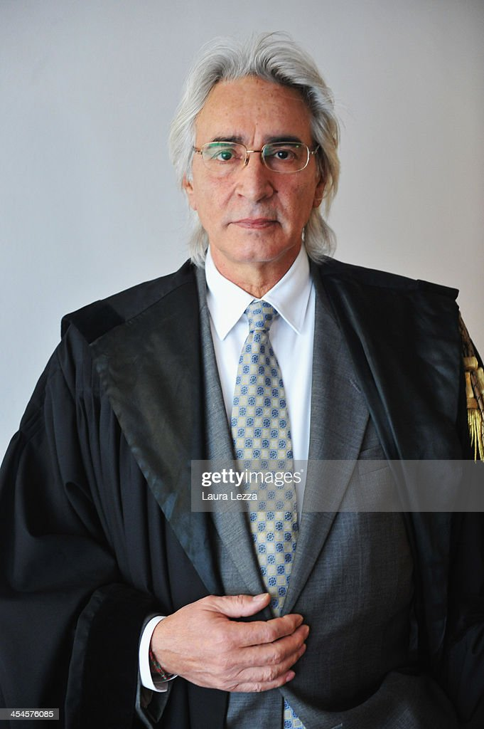 Domenico Pepe, Francesco Schettino's lawyer, poses during the Costa Concordia trial on December 9, 2013 in Grosseto, Italy. Coastguard Captain Gregorio De Falco and Captain Francesco Schettino met for the first time in court today. De Falco, famous for ordering Schettino back onboard after he allegedly abandoned the ship with hundreds of passengers still onboard, took to the stand as a witness. The Costa Concordia capsized on January 13, 2012 leaving 32 people dead.