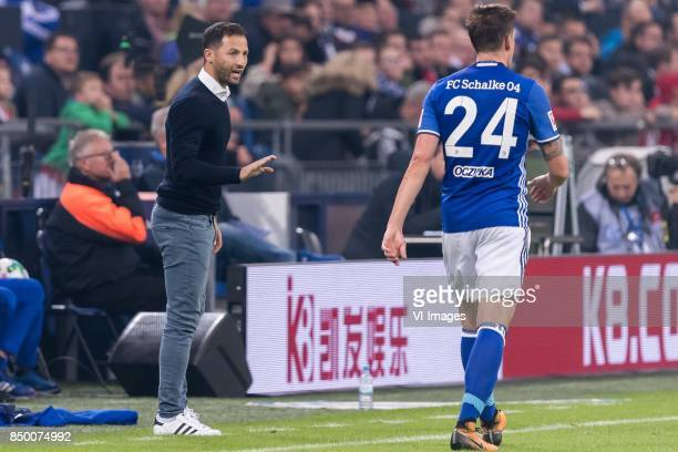 Domenico Tedesco of FC Schalke 04 give instructions to Bastian Oczipka of FC Schalke 04 during the Bundesliga match between Schalke 04 and Bayern...