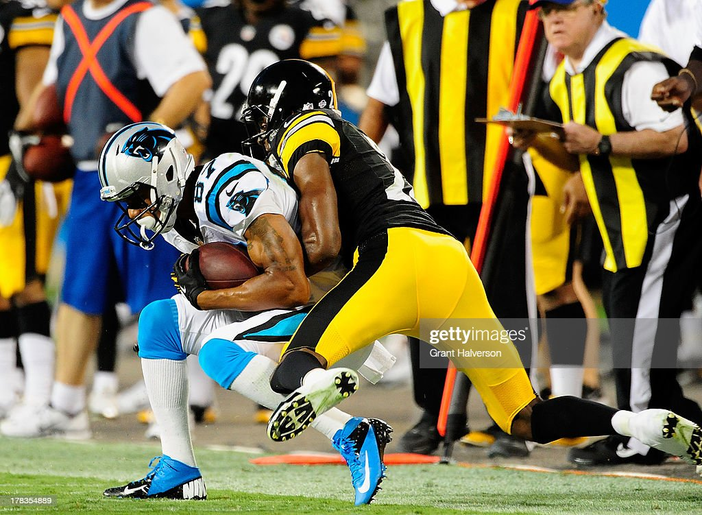 Domenik Hixon #87 of the Carolina Panthers makes a catch along the sideline as he is defended by Cortez Allen #28 of the Pittsburgh Steelers during a preseason NFL game at Bank of America Stadium on August 29, 2013 in Charlotte, North Carolina.