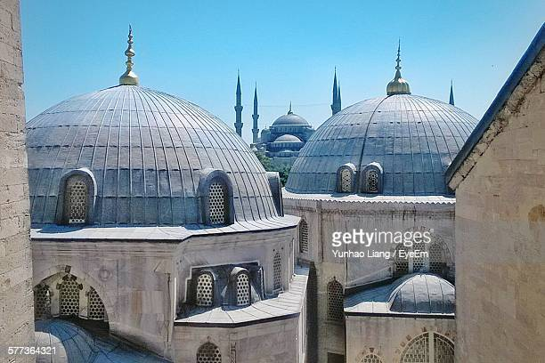 Domes In Front Of Blue Mosque Against Clear Blue Sky
