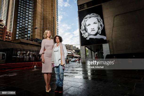 Domestic abuse advocate Felicity Cook is pictured with the artist Noula in front of a portrait of Felicity constructed with 20000 tin lids by the...