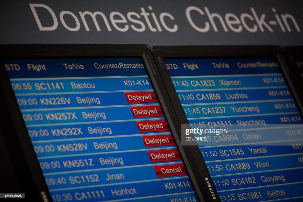 A domestic departures board shows flight delays at Beijing's international airport due to poor visibility on January 23, 2013. China's capital Beijing will strengthen measures to combat pollution, state media reported, amid public anger over the dangerous air quality in the sprawling metropolis. AFP PHOTO / Ed Jones