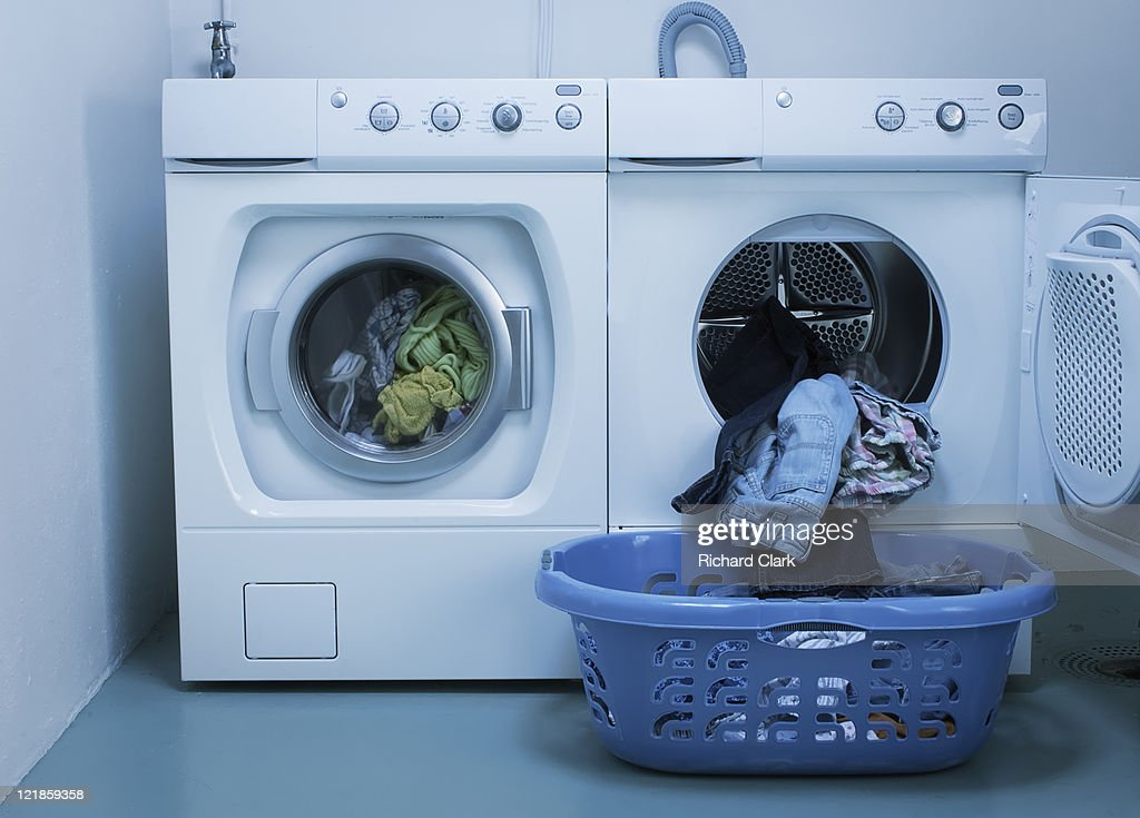 Domestic energy waste: use of washing machine and tumble drier : Stock Photo