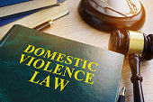 Domestic violence law on a wooden table.