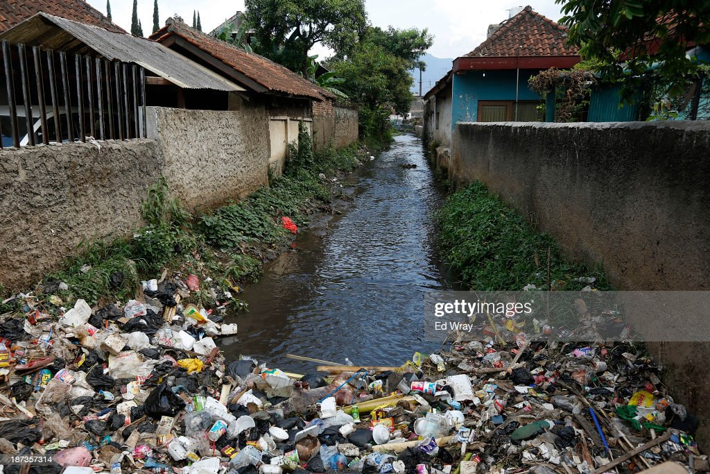 Domestic waste clogs a canal leading into the heavily polluted Citarum river in the town of Majalaya, a major textile producer on November 7, 2013 in Majalaya, Indonesia. The effects of domestic and industrial waste from factories along the river have prompted two leading environmental groups, Green Cross of Switzerland and the Blacksmith Institute, to name the Citarum river as one of the earth's 10 most polluted places in their annual report.