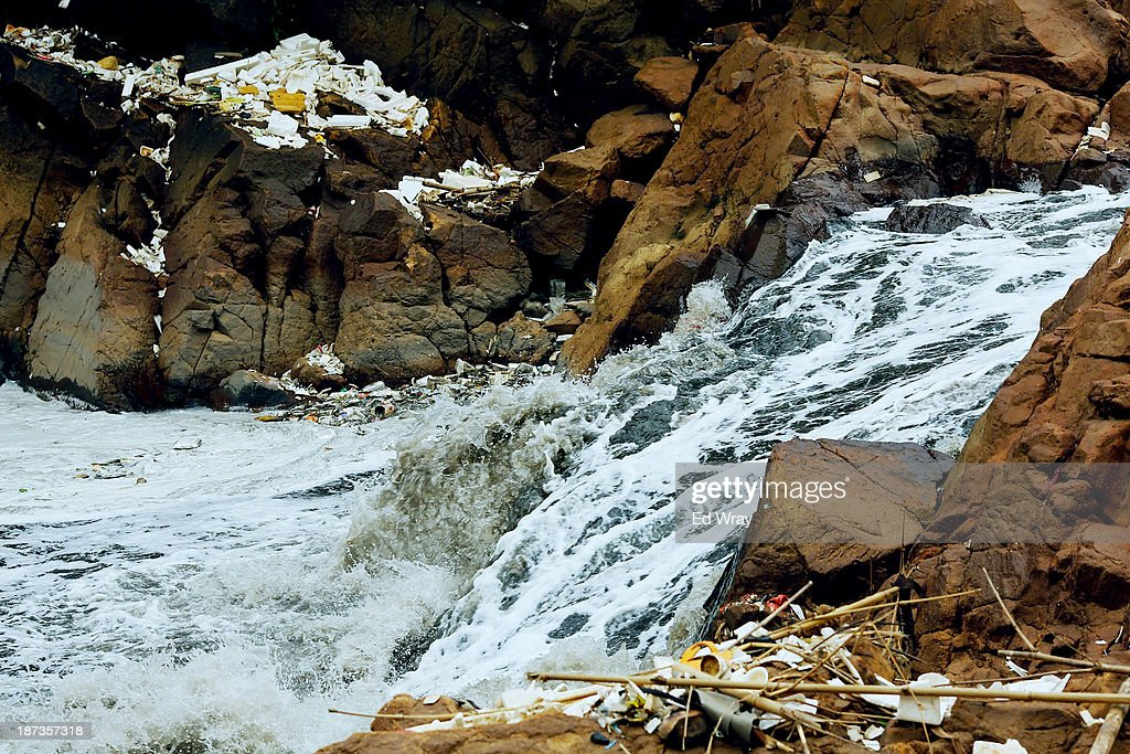 Domestic waste collects in areas next to a waterfall on the heavily polluted Citarum river on November 8, 2013 in Cipatek, Indonesia. The effects of domestic and industrial waste from factories along the river have prompted two leading environmental groups, Green Cross of Switzerland and the Blacksmith Institute, to name the Citarum river as one of the earth's 10 most polluted places in their annual report.