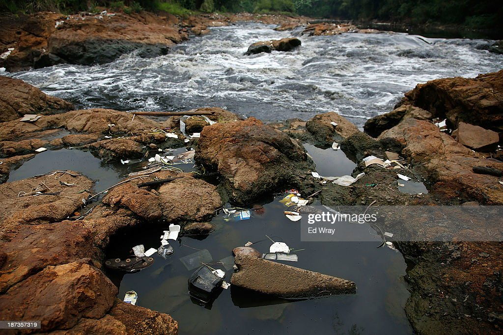 Domestic waste collects in pools next to a waterfall on the Citarum river on November 8, 2013 in Cipatek, Indonesia. The effects of domestic and industrial waste from factories along the river have prompted two leading environmental groups, Green Cross of Switzerland and the Blacksmith Institute, to name the Citarum river as one of the earth's 10 most polluted places in their annual report.