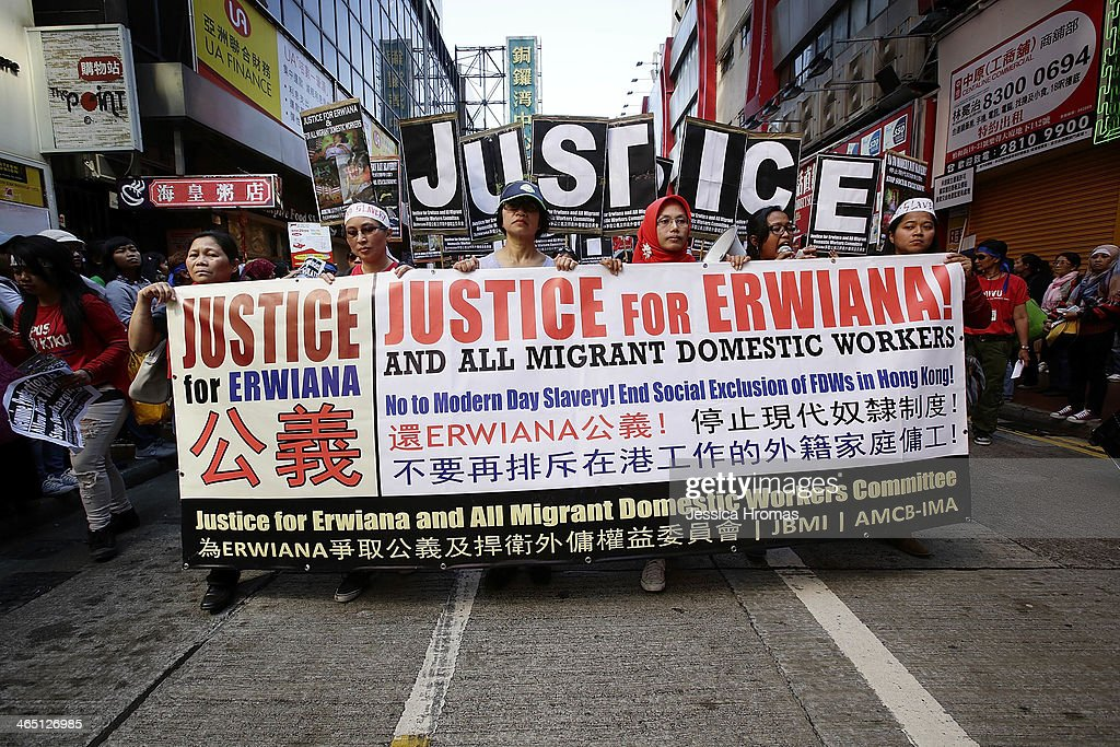 Domestic workers protest in the streets of Causeway Bay to demand better working conditions on January 26, 2014 in Hong Kong. The protest was sparked by the recent revelations of terrible physical abuse of an Indonesian domestic worker Erwiana Sulistyaningsih, 23, while she was working in Hong Kong.