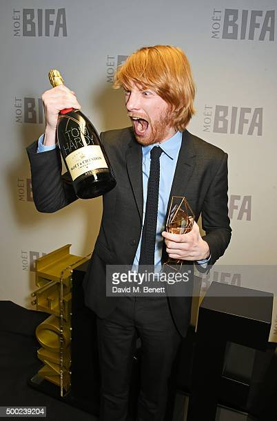 Domhnall Gleeson accepting the Best Actor award on behalf of Tom Hardy for 'Legend' poses at the Moet British Independent Film Awards 2015 at Old...