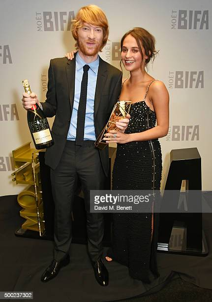 Domhnall Gleeson accepting the Best Supporting Actor award on behalf of his father Brendan Gleeson for 'Suffragette' and presenter Alicia Vikander...