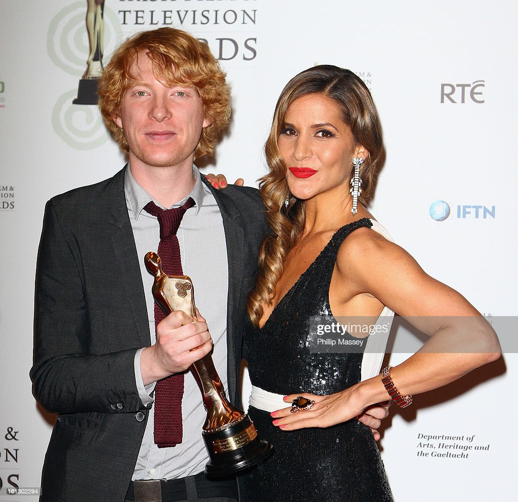 <a gi-track='captionPersonalityLinkClicked' href=/galleries/search?phrase=Domhnall+Gleeson&family=editorial&specificpeople=653261 ng-click='$event.stopPropagation()'>Domhnall Gleeson</a> and <a gi-track='captionPersonalityLinkClicked' href=/galleries/search?phrase=Amanda+Byram&family=editorial&specificpeople=661578 ng-click='$event.stopPropagation()'>Amanda Byram</a> pose in the Press Room after receiving the Best supporting actor in film award for his role in 'Anna Karenina' at the Irish Film and Television Awards at the Convention Centre Dublin on February 9, 2013 in Dublin, Ireland.