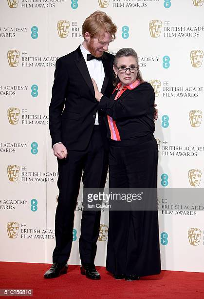 Domhnall Gleeson and Carrie Fisher pose in the winners room at the EE British Academy Film Awards at the Royal Opera House on February 14 2016 in...