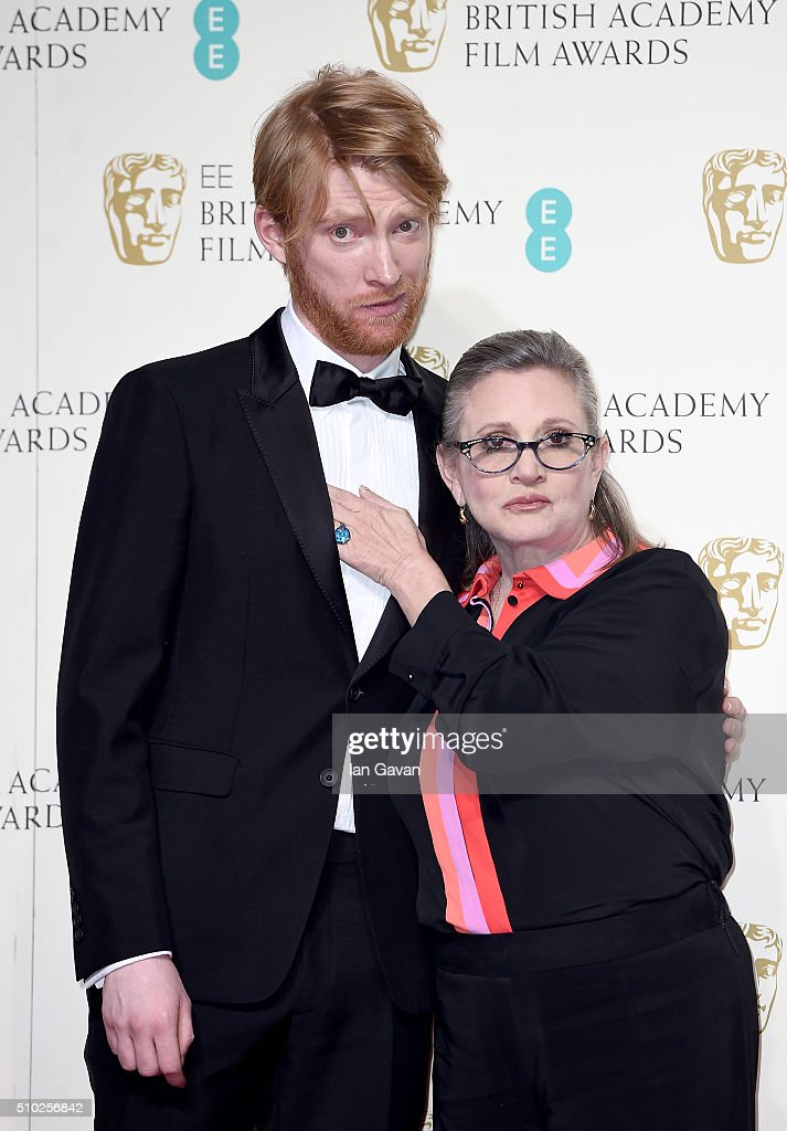 <a gi-track='captionPersonalityLinkClicked' href=/galleries/search?phrase=Domhnall+Gleeson&family=editorial&specificpeople=653261 ng-click='$event.stopPropagation()'>Domhnall Gleeson</a> and <a gi-track='captionPersonalityLinkClicked' href=/galleries/search?phrase=Carrie+Fisher&family=editorial&specificpeople=209183 ng-click='$event.stopPropagation()'>Carrie Fisher</a> pose in the winners room at the EE British Academy Film Awards at the Royal Opera House on February 14, 2016 in London, England.