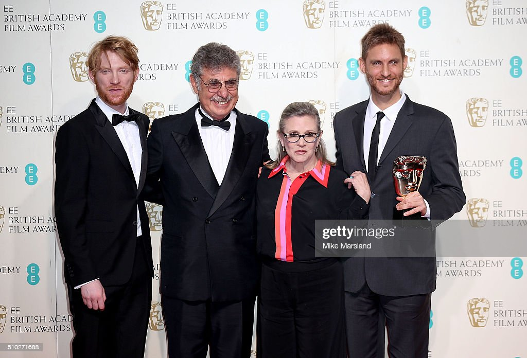 Domhnall Gleeson (L) and Carrie Fisher (2nd R) pose with Hugo Sigman and Damian Szifron, winners of the Film Not In The English Language award for 'Wild Tales', pose in the winners room at the EE British Academy Film Awards at The Royal Opera House on February 14, 2016 in London, England.