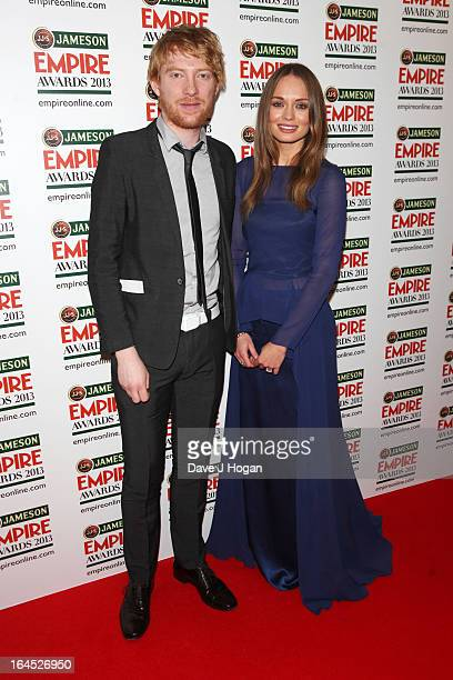 Domhnall Gleeson and Laura Haddock pose in the press room at the Jameson Empire Awards 2013 at Grosvenor House Hotel on March 24 2013 in London...