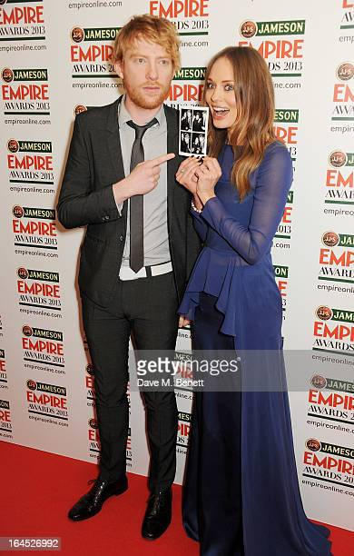 Domhnall Gleeson and Laura Haddock pose in the press room at the Jameson Empire Awards 2013 at The Grosvenor House Hotel on March 24 2013 in London...