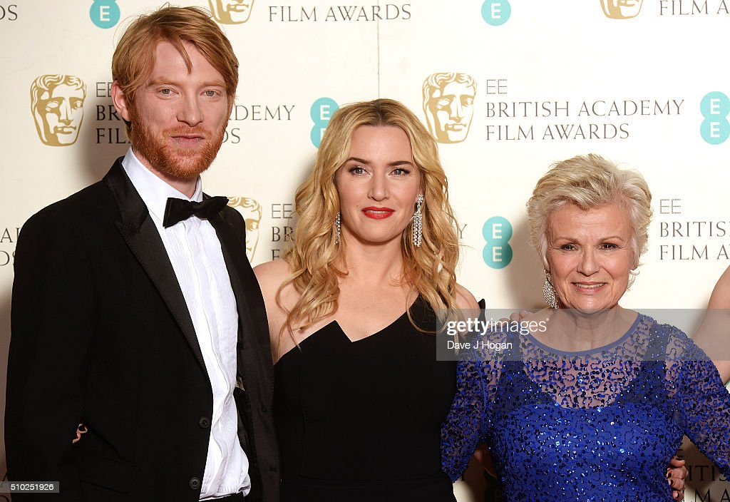 <a gi-track='captionPersonalityLinkClicked' href=/galleries/search?phrase=Domhnall+Gleeson&family=editorial&specificpeople=653261 ng-click='$event.stopPropagation()'>Domhnall Gleeson</a>, <a gi-track='captionPersonalityLinkClicked' href=/galleries/search?phrase=Kate+Winslet&family=editorial&specificpeople=201923 ng-click='$event.stopPropagation()'>Kate Winslet</a> and <a gi-track='captionPersonalityLinkClicked' href=/galleries/search?phrase=Julie+Walters&family=editorial&specificpeople=206570 ng-click='$event.stopPropagation()'>Julie Walters</a> pose in the winners room at the EE British Academy Film Awards at The Royal Opera House on February 14, 2016 in London, England.