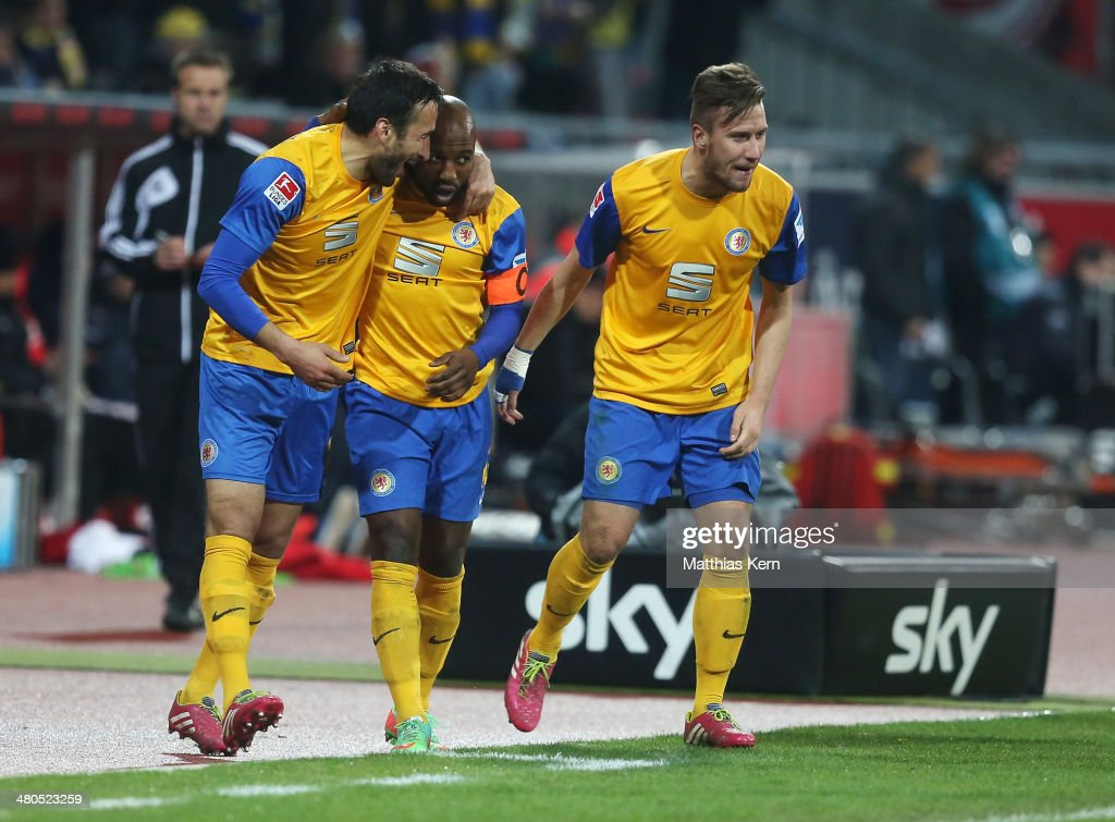 Domi Kumbela of Braunschweig celebrates his second goal with team mates during the Bundesliga match between Eintracht Braunschweig and 1 FSV Mainz 05...