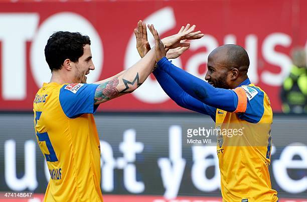 Domi Kumbela of Braunschweig celebrates with Norman Theuerkauf of Braunschweig after scoring the opening goal during the Bundesliga match between 1...