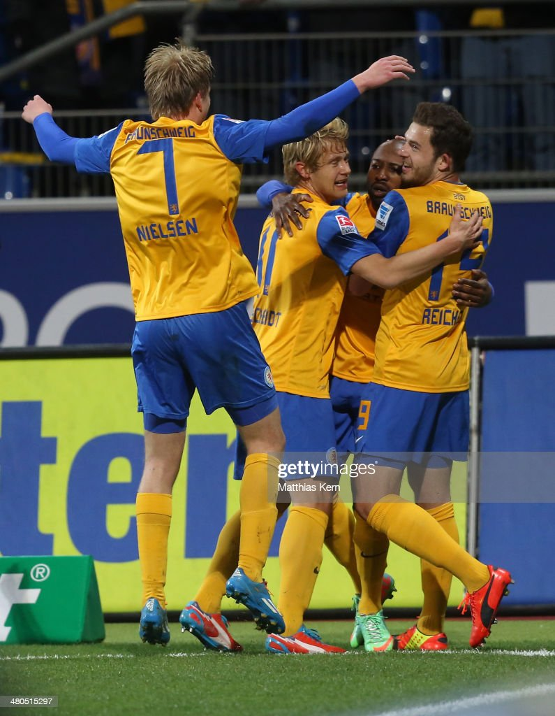 Domi Kumbela of Braunschweig celebrates with team mates after scoring the first goal during the Bundesliga match between Eintracht Braunschweig and 1...
