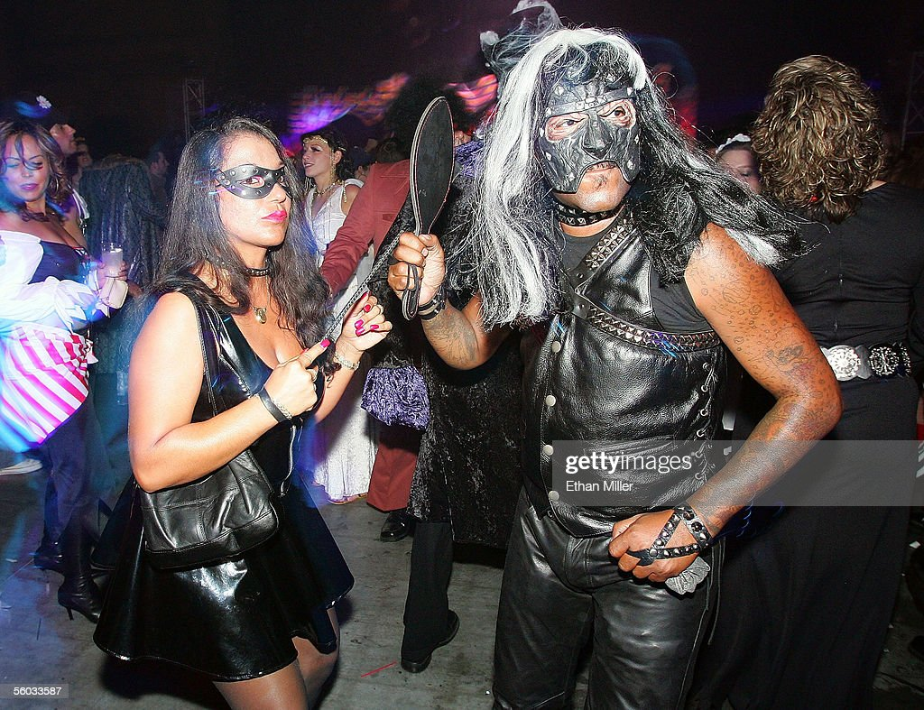 Dominatrix Mistress Contessa (L) and her husband Ken Carey of Nevada dance at the 10th annual Fetish & Fantasy Halloween Ball at the Las Vegas Sports Center on October 29, 2005 in Las Vegas, Nevada.