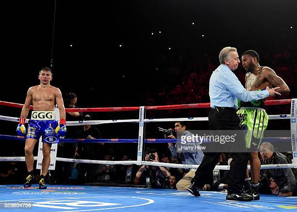 Dominc Wade is counted out by referee Jack Reiss as Gennady Golovkin of Kazakhstan wins in a second round TKO during a unified middleweight title...